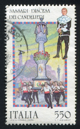 period costume: ITALY - CIRCA 1988: stamp printed by Italy, shows Discesa Dei Candelieri, Sassari: Man wearing period costume, column and bearers, circa 1988