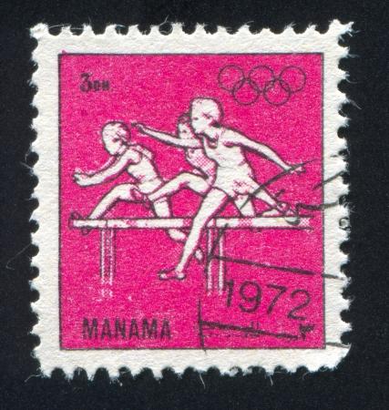 hurdling: MANAMA - CIRCA 1972: stamp printed by Manama, shows Hurdling at Olympics, circa 1972