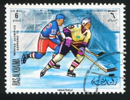 khaima: RAS AL KHAIMA - CIRCA 1972: stamp printed by Ras al Khaima, shows Hockey at Olympic games, circa 1972