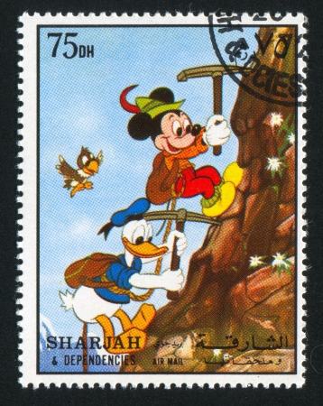 donald: SHARJAH AND DEPENDENCIES - CIRCA 1972: stamp printed by Sharjah and Dependencies, shows Mickey Mouse and Donald Duck, circa 1972 Editorial