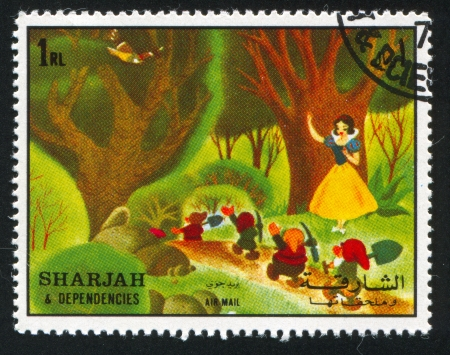 dwarfs: SHARJAH AND DEPENDENCIES - CIRCA 1972: stamp printed by Sharjah and Dependencies, shows Snow White and Seven Dwarfs, circa 1972
