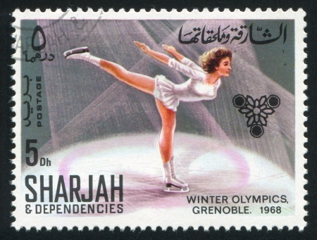 sharjah: SHARJAH AND DEPENDENCIES - CIRCA 1968: stamp printed by Sharjah and Dependencies, shows Figure Skating, circa 1968