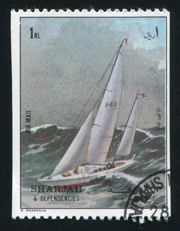 dependencies: SHARJAH AND DEPENDENCIES - CIRCA 1972: stamp printed by Sharjah and Dependencies, shows a Ship, circa 1972 Editorial