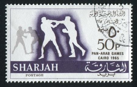 dependencies: SHARJAH AND DEPENDENCIES - CIRCA 1965: stamp printed by Sharjah and Dependencies, shows Boxing, circa 1965