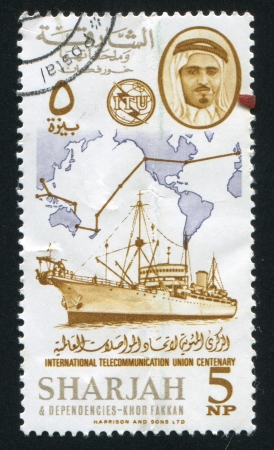 dependencies: SHARJAH AND DEPENDENCIES - CIRCA 1972: stamp printed by Sharjah and Dependencies, shows Ship and Map, circa 1972 Editorial
