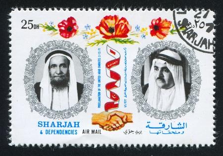 SHARJAH AND DEPENDENCIES - CIRCA 1971: stamp printed by Sharjah and Dependencies, shows Sheikhs, circa 1971 Stock Photo - 17145574