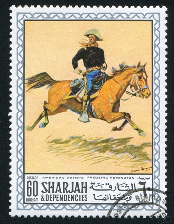 frederic: SHARJAH AND DEPENDENCIES - CIRCA 1972: stamp printed by Sharjah and Dependencies, shows a Painting by Frederic Remington, circa 1972 Editorial