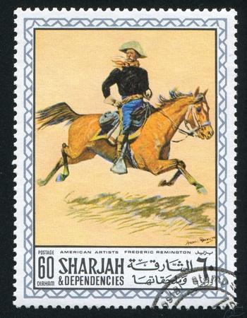 frederic: SHARJAH Y DEPENDENCIAS - CIRCA 1972: sello impreso por Sharjah y sus dependencias, muestra una pintura de Frederic Remington, alrededor del a�o 1972