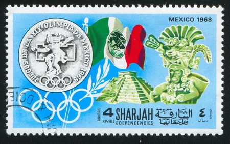 SHARJAH AND DEPENDENCIES - CIRCA 1968: stamp printed by Sharjah and Dependencies, shows Mexico Olympics Symbols, circa 1968