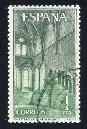 SPAIN - CIRCA 1964: stamp printed by Spain, shows Great Hall, Santa Maria de Huerta Monastery, circa 1964 Stock Photo - 17145458
