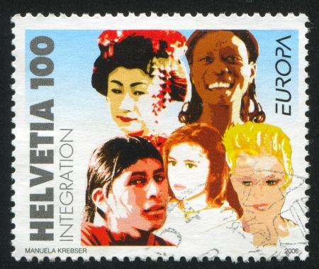 SWITZERLAND - CIRCA 2006: stamp printed by Switzerland, shows People, circa 2006 Stock Photo - 17145299