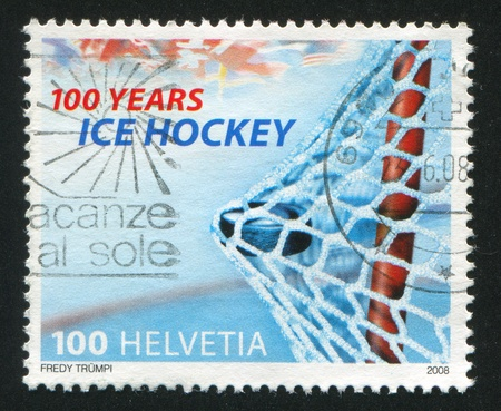 SWITZERLAND - CIRCA 2008: stamp printed by Switzerland, shows Puck in the net, circa 2008 Stock Photo - 17145620
