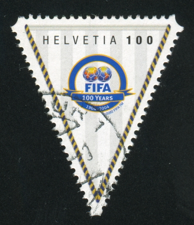 SWITZERLAND - CIRCA 2004: stamp printed by Switzerland, shows FIFA badge, circa 2004 Stock Photo - 17145314