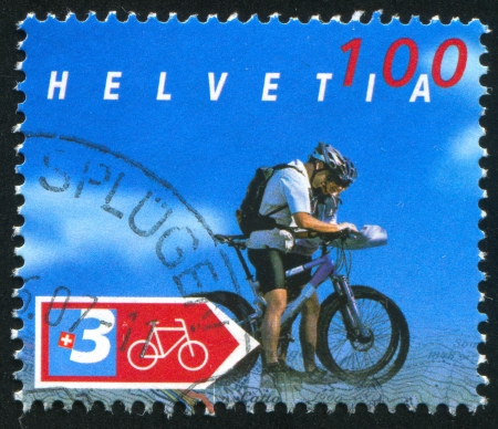 packsack: SWITZERLAND - CIRCA 2004: stamp printed by Switzerland, shows Cyclist and marker for route, circa 2004 Editorial