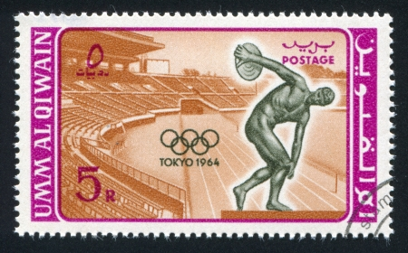 UMM AL-QUWAIN - CIRCA 1964: stamp printed by Umm al-Quwain, shows Stadium and Discobolus, circa 1964 Stock Photo - 17145231