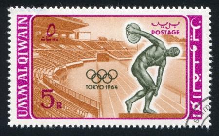 UMM AL-QUWAIN - CIRCA 1964: stamp printed by Umm al-Quwain, shows Stadium and Discobolus, circa 1964 Stock Photo - 17145231