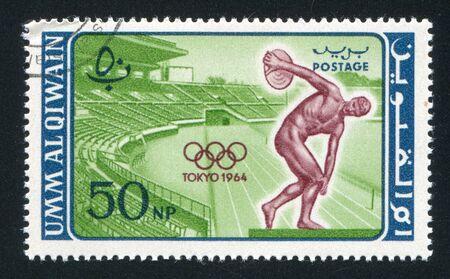 UMM AL-QUWAIN - CIRCA 1964: stamp printed by Umm al-Quwain, shows Stadium and Discobolus, circa 1964 Stock Photo - 17145238