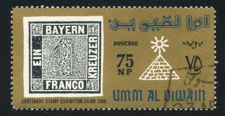 umm: UMM AL-QUWAIN - CIRCA 1966: stamp printed by Umm al-Quwain, shows Stamp and Pyramid, circa 1966