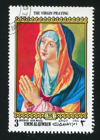 durer: Umm al-Quwain - CIRCA 1972: timbro stampato dalla Umm al-Quwain, mostra la Vergine che prega di Albrecht Durer, circa 1972
