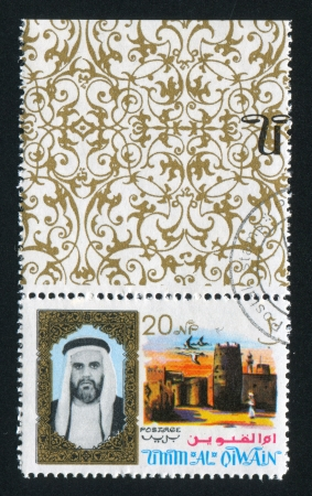 UMM AL-QUWAIN - CIRCA 1972: stamp printed by Umm al-Quwain, shows Sheikh and Geese, circa 1972 Stock Photo - 17145670