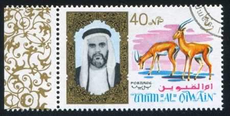 UMM AL-QUWAIN - CIRCA 1972: stamp printed by Umm al-Quwain, shows Sheikh and Antelope, circa 1972 Stock Photo - 17145751