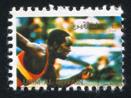 umm: UMM AL-QUWAIN - CIRCA 1972: stamp printed by Umm al-Quwain, shows a Runner, circa 1972 Editorial