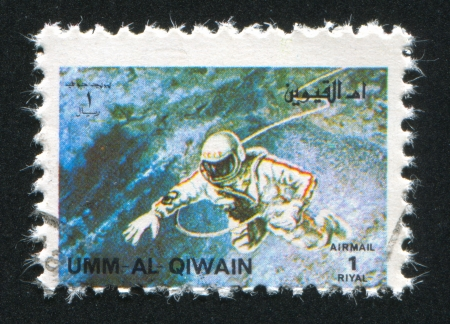 umm: UMM AL-QUWAIN - CIRCA 1972: stamp printed by Umm al-Quwain, shows Alexei Leonov spacewalking during Voskhod 2, circa 1972 Editorial