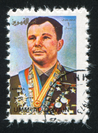 UMM AL-QUWAIN - CIRCA 1972: stamp printed by Umm al-Quwain, shows Yuri Gagarin, circa 1972 Stock Photo - 17145362