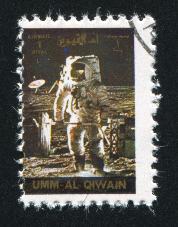 UMM AL-QUWAIN - CIRCA 1972: stamp printed by Umm al-Quwain, shows Apollo Moonwalker, circa 1972 Stock Photo - 17145675