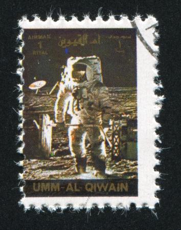 UMM AL-QUWAIN - CIRCA 1972: stamp printed by Umm al-Quwain, shows Apollo Moonwalker, circa 1972 Stock Photo - 17145675