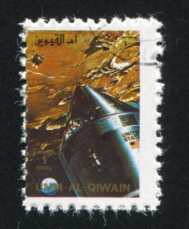 UMM AL-QUWAIN - CIRCA 1972: stamp printed by Umm al-Quwain, shows Gemini Spacecraft, circa 1972 Stock Photo - 17145691