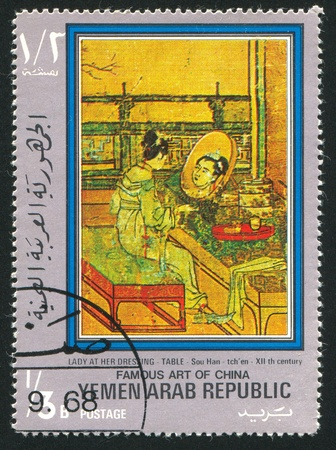 YEMEN - CIRCA 1972: stamp printed by Yemen, shows Lady at her dressing table by Su Han Chen, circa 1972 Stock Photo - 17145570