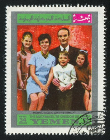 YEMEN - CIRCA 1972: stamp printed by Yemen, shows Michael Collins with the family, circa 1972 Stock Photo - 17145229
