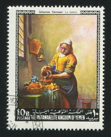 YEMEN - CIRCA 1972: stamp printed by Yemen, shows The Milkmaid by Vermeer, circa 1972 Stock Photo - 17145224