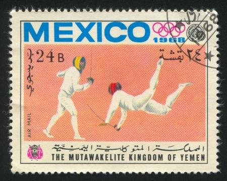 YEMEN - CIRCA 1968: stamp printed by Yemen, shows Fencing, circa 1968 Stock Photo - 17145212