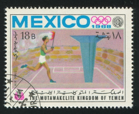 YEMEN - CIRCA 1968: stamp printed by Yemen, shows Sportsman and Olympic fire, circa 1968 Stock Photo - 17145217