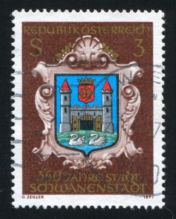AUSTRIA - CIRCA 1977: stamp printed by Austria, shows Schwanenstadt, town arms, circa 1977 Stock Photo - 17437450