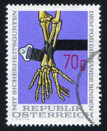 AUSTRIA - CIRCA 1975: stamp printed by Austria, shows Safety Belt and Skeleton Arms, circa 1975 Stock Photo - 17437471