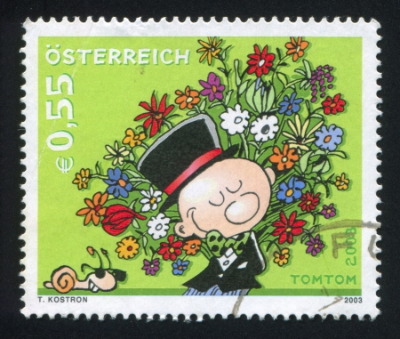 AUSTRIA - CIRCA 2003: stamp printed by Austria, shows Man with flowers, circa 2003 Stock Photo - 17464389