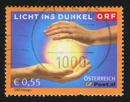 ins: AUSTRIA - CIRCA 2003: stamp printed by Austria, shows Licht Ins Dunkel Fund-Raising Campaign for the Handicapped, circa 2003