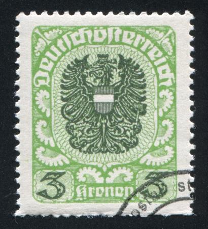 AUSTRIA - CIRCA 1920: stamp printed by Austria, shows ornament and eagle, circa 1920 Stock Photo - 17437411