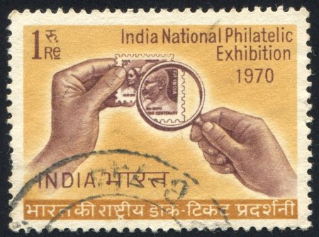 INDIA - CIRCA 1970: stamp printed by India, shows magnifying glass and stamp, circa 1970