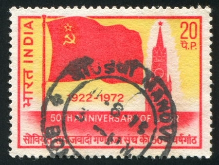 INDIA - CIRCA 1972: stamp printed by India, shows Flag of USSR and Spasski Tower, circa 1972 Stock Photo - 17464462