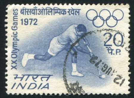 INDIA - CIRCA 1972: stamp printed by India, shows Hockey player, Olympic Rings, circa 1972 Stock Photo - 17464630
