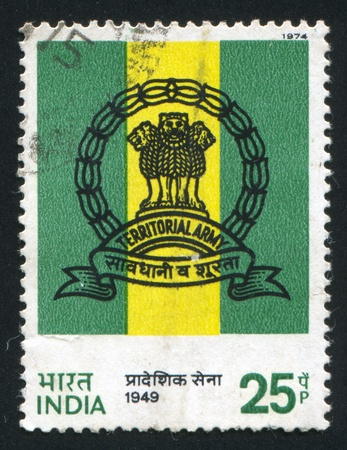 INDIA - CIRCA 1974: stamp printed by India, shows Territorial Army Emblem, circa 1974 Stock Photo - 17437460