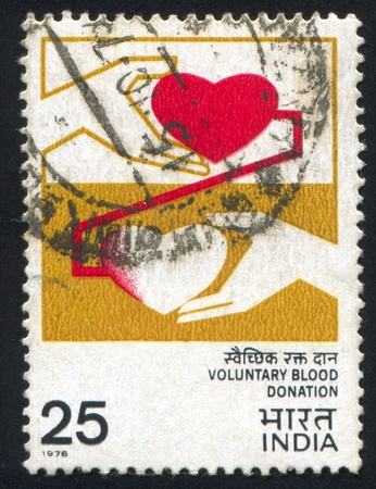 INDIA - CIRCA 1976: stamp printed by India, shows hand and heart, circa 1976 Stock Photo - 17437381