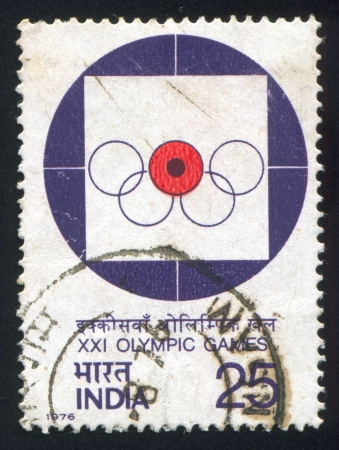 olympic rings: INDIA - CIRCA 1976: stamp printed by India, shows Target, Olympic Rings, circa 1976