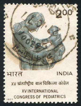 INDIA - CIRCA 1977: stamp printed by India, shows Mother and Child, Khajuraho Sculpture, circa 1977