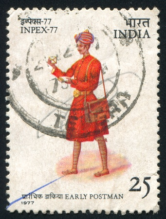clasp feet: INDIA - CIRCA 1977: stamp printed by India, shows Postman, circa 1977
