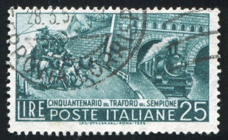 ITALY - CIRCA 1956: stamp printed by Italy, shows Mail Coach and Tunnel Exit, circa 1956